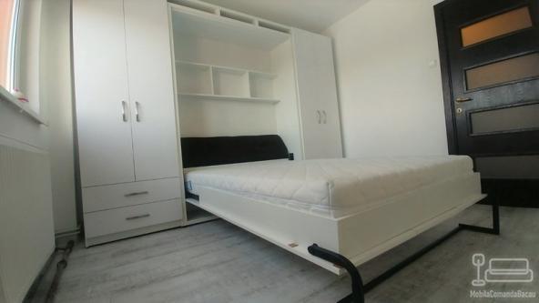 Dormitor alb cu pat rabatabil si spatii de depozitare D 295